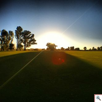 Sun setting over a polo field at La Bamba de Areco