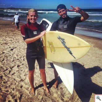 Jenny and Joaquin surfing the break in Uruguay