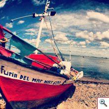 Colorful boats on shore of Jose Ignacio