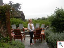 Julie at the fire pit at Hyatt Carmel Highands resort, CA